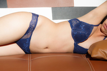 Woman sexy underwear on sofa