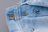 part of denim pants with pocket and unbuttoned buttons, close-up - 219379985