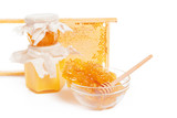 jar of honey and stick isolated on white background - 219392506