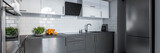 Modern kitchen in gray and white - 219403164