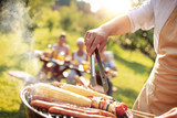 Happy family having barbecue party in backyard - 219436106