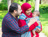 An Arabic couple is talking to their crying baby - 219440387