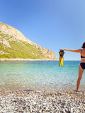 Woman with flippers snorkeling tube on beach - 219459560
