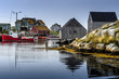 Idle day at Peggy's Cove - Fishing boat is idle and docked in the clam waters of Peggy's Cove on a quiet day - September 16, 2017.