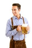 Junger Mann in bayerischer Tracht mit Bierkrug - 219464757