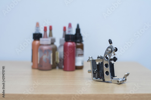 tattoo gun machine and ink in background | Buy Photos | AP Images ...