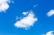 little fluffy cloud in dark blue sky in summer day - 219475921