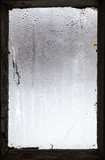 water drops from melting snow on misted window