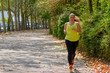 Quadro Determined middle-aged woman jogging in the park