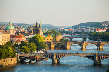 Scenic spring sunset aerial view of the Old Town pier architecture and Charles Bridge over Vltava river in Prague, Czech Republic © Khritthithat