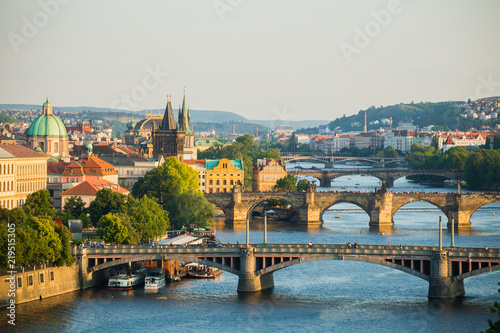 Naklejka Scenic spring sunset aerial view of the Old Town pier architecture and Charles Bridge over Vltava river in Prague, Czech Republic