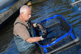 senior fish farm worker - 219527196