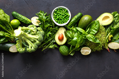 Foto Murales Raw healthy food clean eating vegetables green vegetables top view