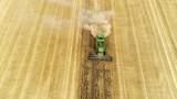 4K AERIAL video: Harvester-trasher  - 219583162