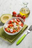 salad with mozzarella tomatoes and avocado - 219587757