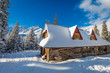 Mountain huts and sunrise in winter, Poland, Europe