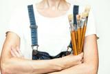 girl painter holds a brush - 219599373