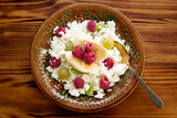 Healthy and delicious breakfast. Cottage cheese with fresh fruit (raspberry, kiwifruit, grapes). - 219600154