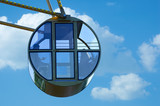 Cab of Ferris wheel against the sky with clouds. - 219608727
