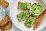 Delicious appetizer - butter with dill greens on rye bread with sunflower seeds - 219625945