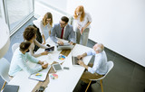 Top view at business people in office - 219630356