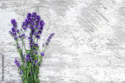 Lavender flowers bouquet on rustic wooden background. top view with copy space - 219633735