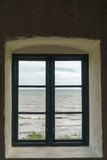 Old window with view over sea