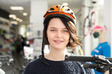Portrait of smiling female in helmet - 219664319
