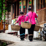 Woman with bamboo baskets