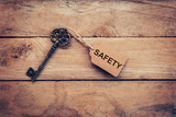 Old key and tag lable SAFETY for on wooden for business concept. - 219680744