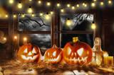 Scary halloween pumpkins on wooden planks - 219682519
