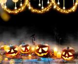 Spooky halloween pumpkins on wooden planks - 219682556