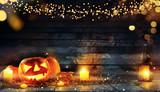 Spooky halloween pumpkins on wooden planks - 219682569