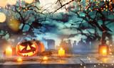 Spooky halloween pumpkins on wooden planks - 219682578