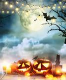 Spooky halloween pumpkins on wooden planks - 219682584