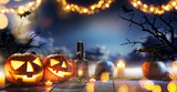 Spooky halloween pumpkins on wooden planks - 219683306