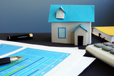Property investment. Model of house on an office table. - 219684310
