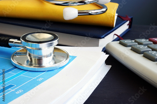 Naklejka Accounting. Stethoscope and financial report with statistics. Analytic research.