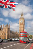 Big Ben with red bus in London, England, UK - 219688975
