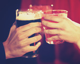 Friends toasting glasses in a pub - 219690960