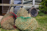 Hay nets with a stable backdrop - 219691547