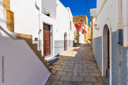 Beautiful narrow street of historic Lindos. Rhodes island, Greece