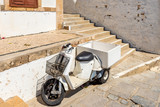 Typical Greek scooter parked on narrow street of Lindos. Rhodes island, Greece