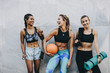 Smiling fitness women standing outdoors after workout