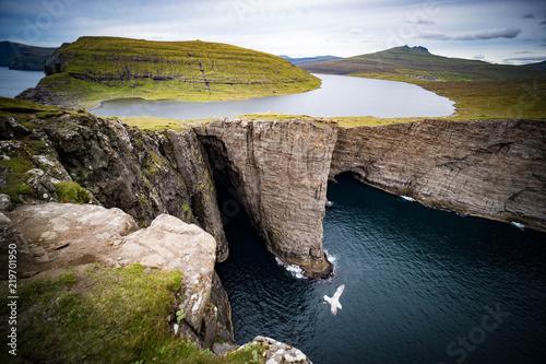 Leinwandbild Motiv Sørvágsvatn or Leitisvatn is the largest lake in the Faroe Islands.