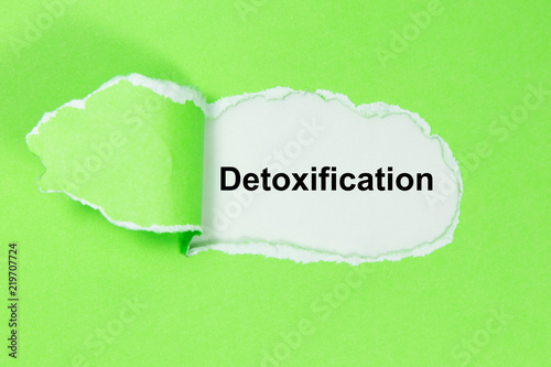 Leinwanddruck Bild The word Detoxification appearing behind ripped paper.