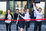 Business people crossing the finish line - 219709116