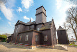 Wooden church from 1776 year in cozy village center Leki Wielkie in Greater Poland province - 219711390