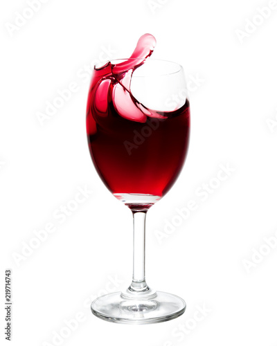 Fototapeta Red wine splash out of glass. Isolated on white background.
