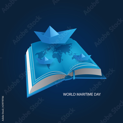 Fototapeta international maritime day concept with book and paper boat
